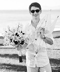 Portrait of Sean Gallagher holding orchids and an umbrella in Puerto Vallarta, Jalisco, Mexico